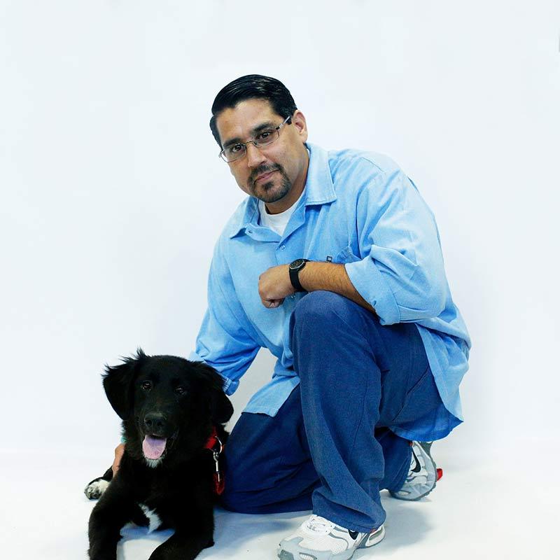 Black puppy and trainer Jesse